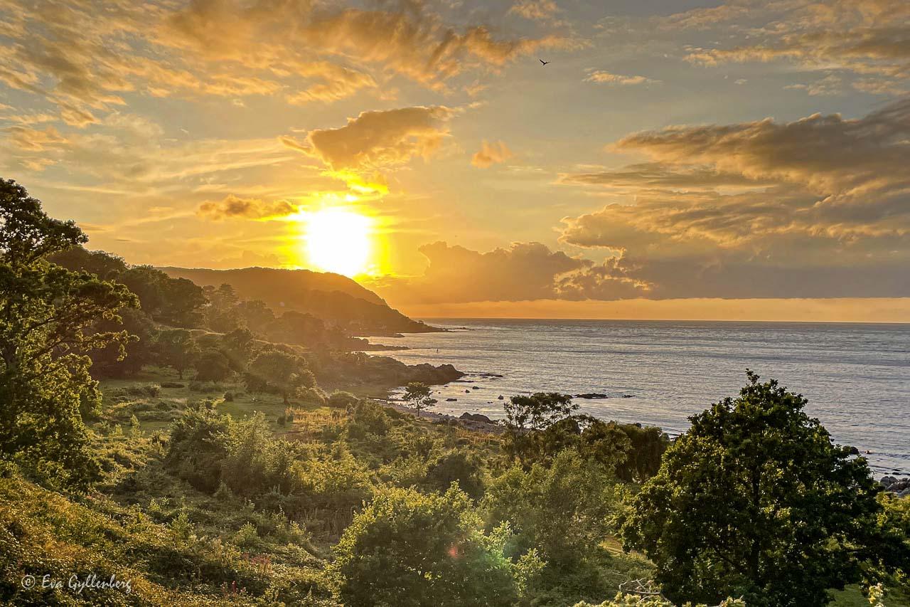 Solnedgång över Arild och Kullaberg